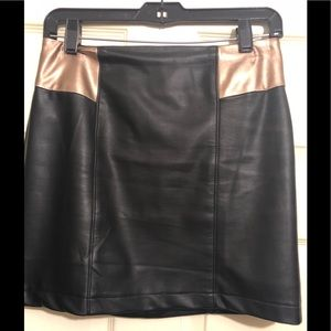 Vegan black leather mini skirt with bronze accents